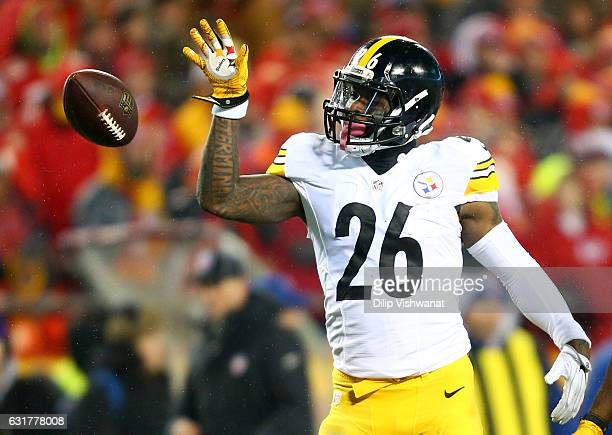 Running back Le'Veon Bell of the Pittsburgh Steelers tosses the ball forward after gaining a first down against the Kansas City Chiefs during the...