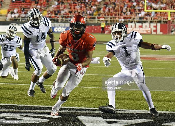 Running back Lexington Thomas of the UNLV Rebels scores a touchdown against defensive back Brandon Maiden of the Jackson State Tigers during their...