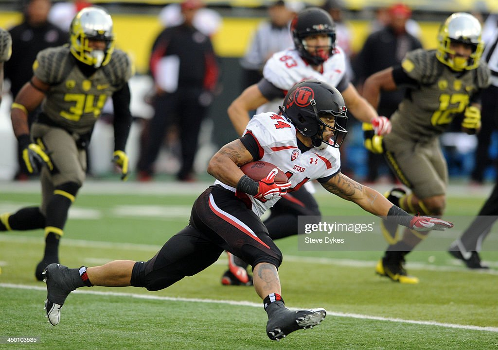 Running back Lucky Radley #44 of the Utah Utes runs with the ball during the third quarter of the game against the Oregon Ducks at Autzen Stadium on November 16, 2013 in Eugene, Oregon.