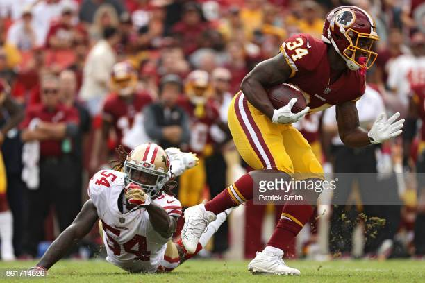 Running back Mack Brown of the Washington Redskins eludes outside linebacker RayRay Armstrong of the San Francisco 49ers during the second quarter at...