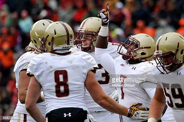 Running back Marcus Outlow of the Boston College Eagles celebrates his touchdown reception in the second half against the Virginia Tech Hokies at...
