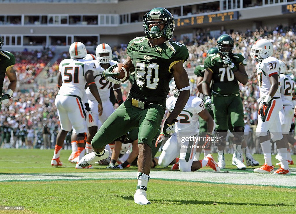 Running back Marcus Shaw #20 of the South Florida Bulls rushes into the end zone for a 3-yard touchdown in the first quarter against the Miami Hurricanes on September 28, 2013 at Raymond James Stadium in Tampa, Florida.
