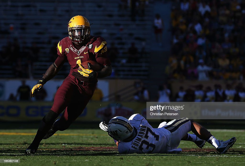 Running back Marion Grice #1 of the Arizona State Sun Devils rushes the football past linebacker Princeton Fuimaono #37 of the Washington Huskies during the college football game at Sun Devil Stadium on October 19, 2013 in Tempe, Arizona. The Sun Devils defeated the Huskies 53-24.