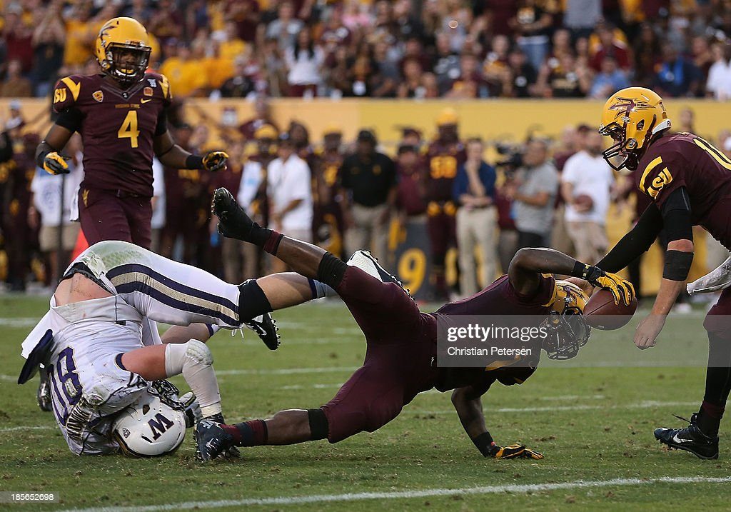 Running back Marion Grice #1 of the Arizona State Sun Devils rushes the football against the Washington Huskies during the college football game at Sun Devil Stadium on October 19, 2013 in Tempe, Arizona. The Sun Devils defeated the Huskies 53-24.