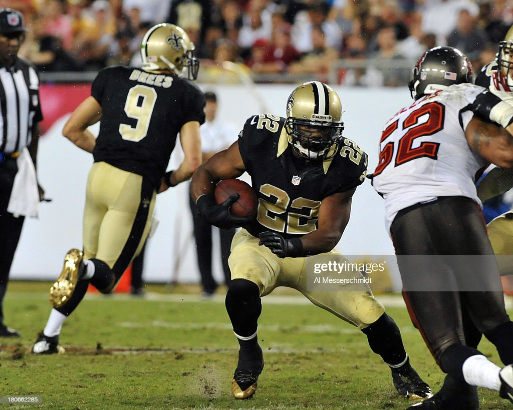 Running back <a gi-track='captionPersonalityLinkClicked' href=/galleries/search?phrase=Mark+Ingram&family=editorial&specificpeople=578256 ng-click='$event.stopPropagation()'>Mark Ingram</a> #22 of the New Orleans Saints rushes upfield in the 3rd quarter against the Tampa Bay Buccaneers September 15, 2013 at Raymond James Stadium in Tampa, Florida.