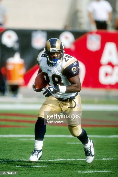 Running back Marshall Faulk of the St Louis Rams runs upfield during a 14 to 27 win over the Arizona Cardinals on Mike Moore