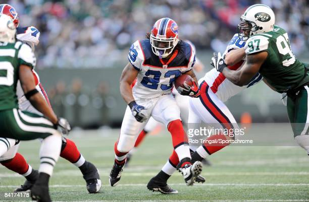 Running back Marshawn Lynch of the Buffalo Bills rushes against the New York Jets on December 14 2008 at Giants Stadium in East Rutherford New Jersey...