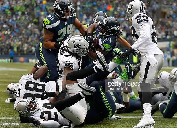 Running back Marshawn Lynch of the Seattle Seahawks bulls his way into the end zone for a touchdown during the first quarter of the game against the...