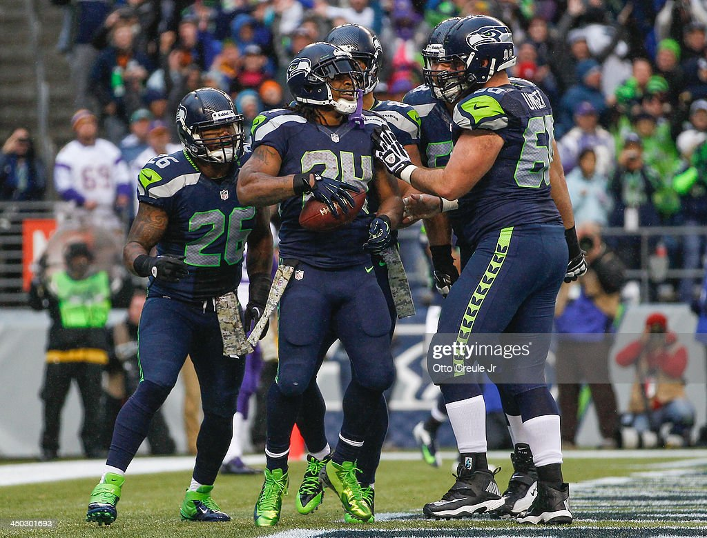 Running back <a gi-track='captionPersonalityLinkClicked' href=/galleries/search?phrase=Marshawn+Lynch&family=editorial&specificpeople=2159904 ng-click='$event.stopPropagation()'>Marshawn Lynch</a> #24 of the Seattle Seahawks celebrates with teammates after scoring a touchdown in the fourth quarter against the Minnesota Vikings at CenturyLink Field on November 17, 2013 in Seattle, Washington. The Seahawks defeated the Vikings 41-20.