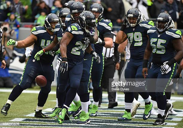 Running back Marshawn Lynch of the Seattle Seahawks celebrates with his teammates after scoring a touchdown during the first quarter of the game...