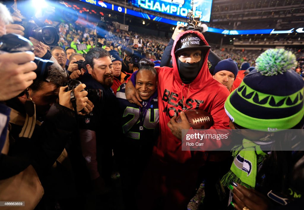 Running back <a gi-track='captionPersonalityLinkClicked' href=/galleries/search?phrase=Marshawn+Lynch&family=editorial&specificpeople=2159904 ng-click='$event.stopPropagation()'>Marshawn Lynch</a> #24 of the Seattle Seahawks celebrates with his mother Delisa Lynch after their 43-8 victory over the Denver Broncos during Super Bowl XLVIII at MetLife Stadium on February 2, 2014 in East Rutherford, New Jersey.