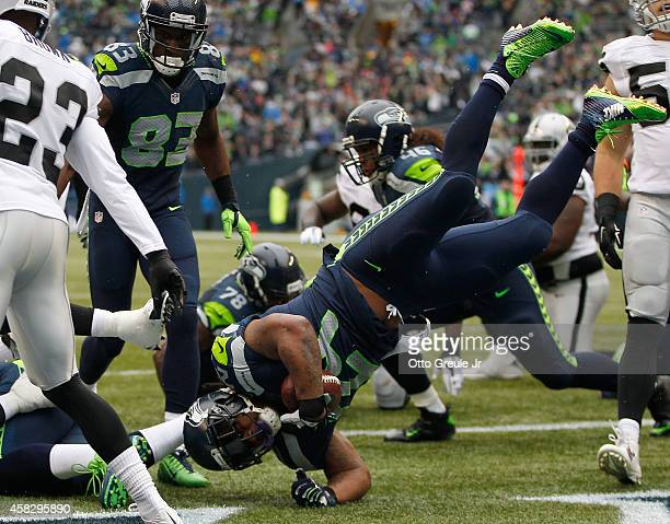 Running back Marshawn Lynch of the Seattle Seahawks flips into the end zone for a touchdown during the first quarter of the game against the Oakland...