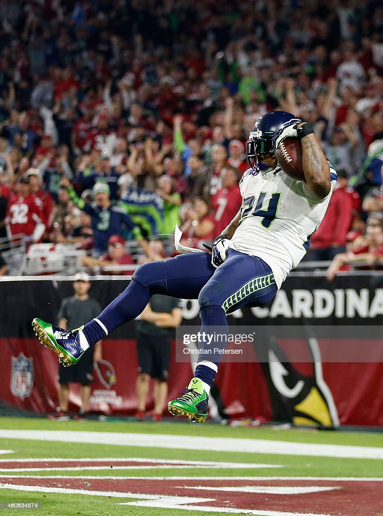 Back marshawn lynch of the seattle seahawks leaps to score a 79 yard