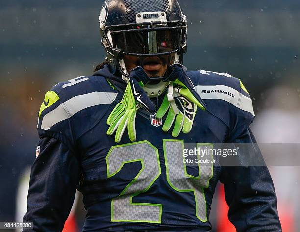 Running back Marshawn Lynch of the Seattle Seahawks looks on prior to the game against the Denver Broncos at CenturyLink Field on August 14 2015 in...