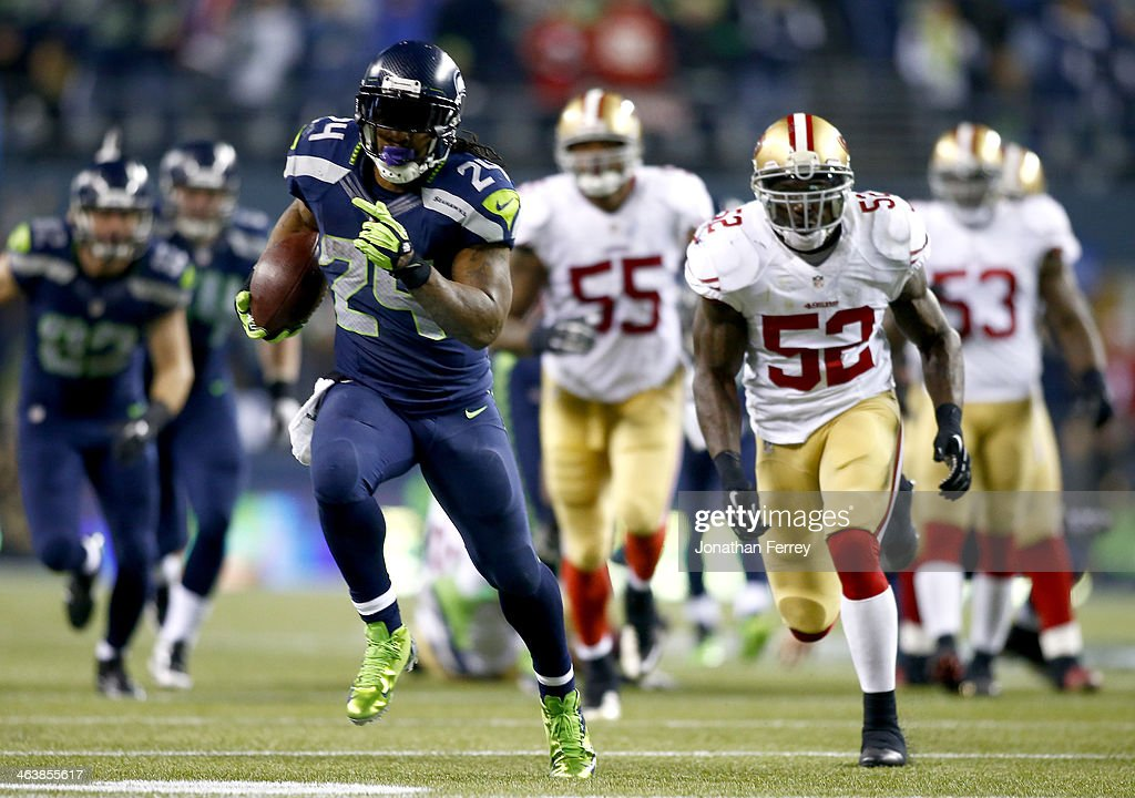 Running back <a gi-track='captionPersonalityLinkClicked' href=/galleries/search?phrase=Marshawn+Lynch&family=editorial&specificpeople=2159904 ng-click='$event.stopPropagation()'>Marshawn Lynch</a> #24 of the Seattle Seahawks runs for a 40-yard touchdown in the third quarter against the San Francisco 49ers during the 2014 NFC Championship at CenturyLink Field on January 19, 2014 in Seattle, Washington.