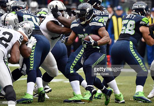 Running back Marshawn Lynch of the Seattle Seahawks runs with the ball during the first quarter of the game against the Oakland Raiders at...