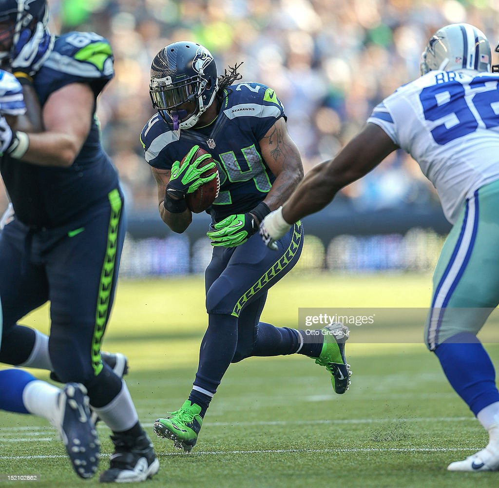 Running back <a gi-track='captionPersonalityLinkClicked' href=/galleries/search?phrase=Marshawn+Lynch&family=editorial&specificpeople=2159904 ng-click='$event.stopPropagation()'>Marshawn Lynch</a> #24 of the Seattle Seahawks rushes against the Dallas Cowboys at CenturyLink Field on September 16, 2012 in Seattle, Washington.