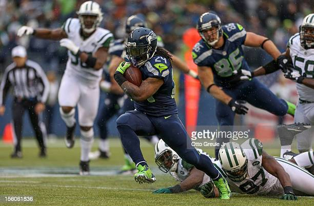 Running back Marshawn Lynch of the Seattle Seahawks rushes against the New York Jets at CenturyLink Field on November 11 2012 in Seattle Washington...