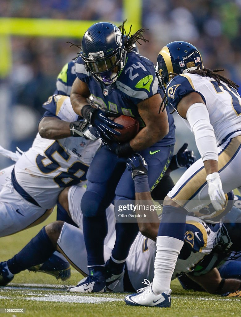 Running back Marshawn Lynch #24 of the Seattle Seahawks rushes against the St. Louis Rams at CenturyLink Field on December 30, 2012 in Seattle, Washington. The Seahawks defeated the Rams 20-13.