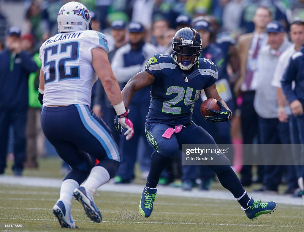 Running back Marshawn Lynch of the Seattle Seahawks rushes against linebacker Colin McCarthy of the Tennessee Titans at CenturyLink Field on October...