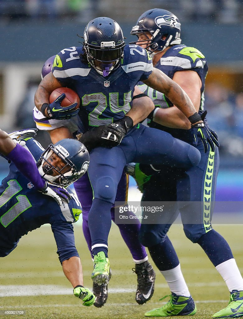 Running back <a gi-track='captionPersonalityLinkClicked' href=/galleries/search?phrase=Marshawn+Lynch&family=editorial&specificpeople=2159904 ng-click='$event.stopPropagation()'>Marshawn Lynch</a> #24 of the Seattle Seahawks rushes against the Minnesota Vikings at CenturyLink Field on November 17, 2013 in Seattle, Washington. The Seahawks defeated the Vikings 41-20.