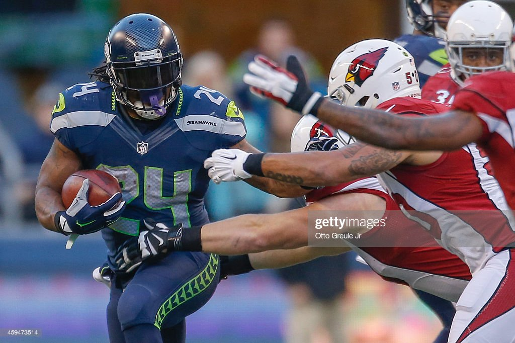Running back <a gi-track='captionPersonalityLinkClicked' href=/galleries/search?phrase=Marshawn+Lynch&family=editorial&specificpeople=2159904 ng-click='$event.stopPropagation()'>Marshawn Lynch</a> #24 of the Seattle Seahawks rushes against the Arizona Cardinals at CenturyLink Field on November 23, 2014 in Seattle, Washington. The Seahawks defeated the Cardinals 19-3.