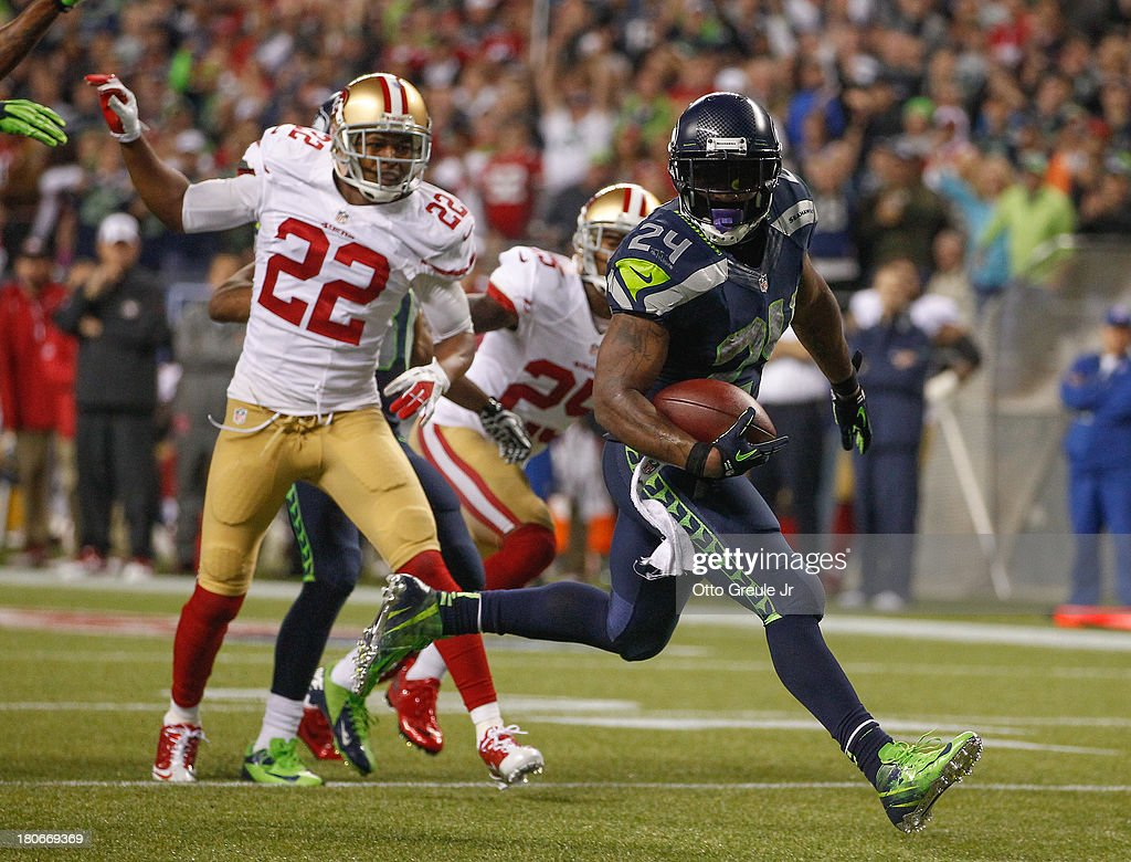 Running back <a gi-track='captionPersonalityLinkClicked' href=/galleries/search?phrase=Marshawn+Lynch&family=editorial&specificpeople=2159904 ng-click='$event.stopPropagation()'>Marshawn Lynch</a> #24 of the Seattle Seahawks rushes for a touchdown in the third quarter against the San Francisco 49ers at CenturyLink Field on September 15, 2013 in Seattle, Washington.