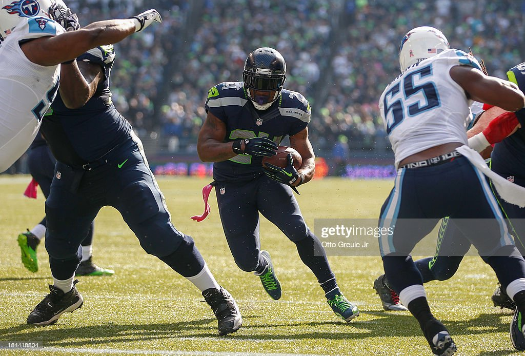 Running back Marshawn Lynch of the Seattle Seahawks rushes for a touchdown in the second quarter against the Tennessee Titans at CenturyLink Field on...