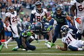 Running back Marshawn Lynch of the Seattle Seahawks rushes for the winning touchdown in overtime against the Denver Broncos at CenturyLink Field on...
