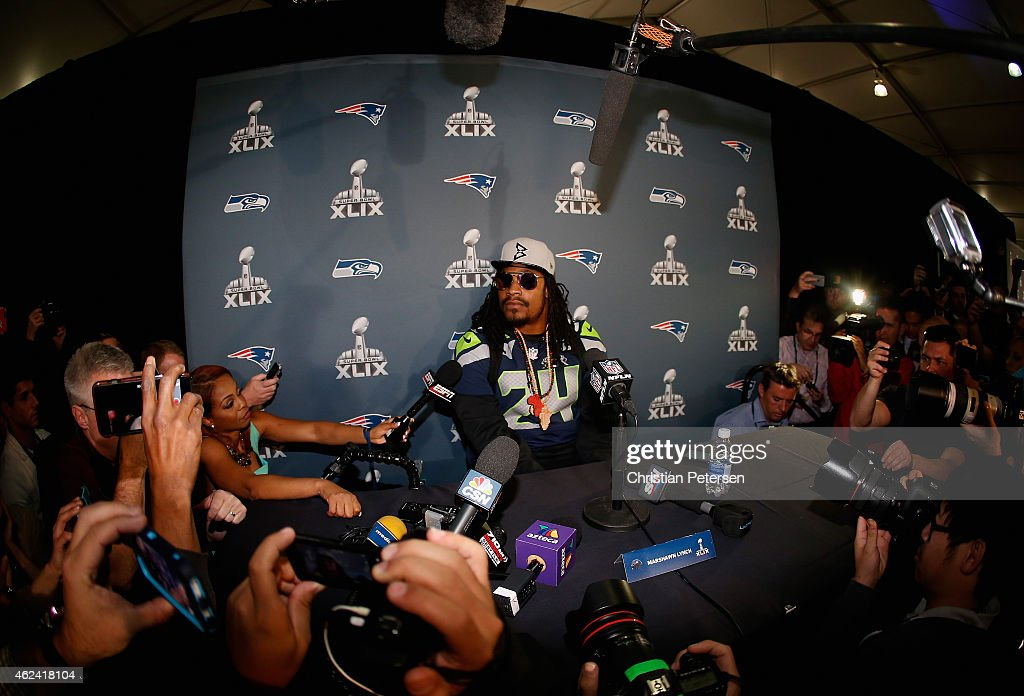 Running back <a gi-track='captionPersonalityLinkClicked' href=/galleries/search?phrase=Marshawn+Lynch&family=editorial&specificpeople=2159904 ng-click='$event.stopPropagation()'>Marshawn Lynch</a> #24 of the Seattle Seahawks sits at his podium during a Super Bowl XLIX media availability at the Arizona Grand Hotel on January 28, 2015 in Chandler, Arizona.