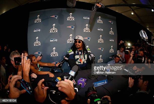 Running back Marshawn Lynch of the Seattle Seahawks sits at his podium during a Super Bowl XLIX media availability at the Arizona Grand Hotel on...