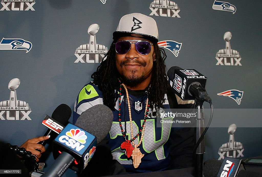 Running back <a gi-track='captionPersonalityLinkClicked' href=/galleries/search?phrase=Marshawn+Lynch&family=editorial&specificpeople=2159904 ng-click='$event.stopPropagation()'>Marshawn Lynch</a> #24 of the Seattle Seahawks speaks during a Super Bowl XLIX media availability at the Arizona Grand Hotel on January 28, 2015 in Chandler, Arizona.