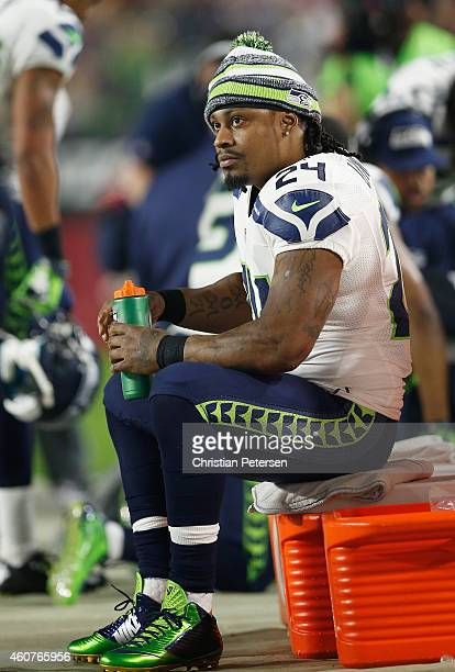 Running back Marshawn Lynch of the Seattle Seahawks watches from the sidelines during the NFL game against the Arizona Cardinals at the University of...