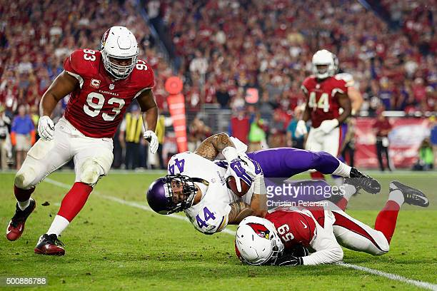 Running back Matt Asiata of the Minnesota Vikings is tackled by outside linebacker Alani Fua of the Arizona Cardinals after rushing the football...