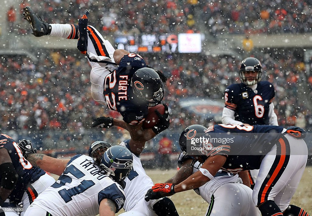 Running back <a gi-track='captionPersonalityLinkClicked' href=/galleries/search?phrase=Matt+Forte&family=editorial&specificpeople=2246847 ng-click='$event.stopPropagation()'>Matt Forte</a> #22 of the Chicago Bears attempts to jump into the endzone but is stopped short in the second quarter against the Seattle Seahawks in the 2011 NFC divisional playoff game at Soldier Field on January 16, 2011 in Chicago, Illinois.