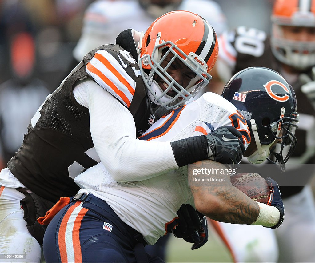 Running back Matt Forte of the Chicago Bears is tackled by linebacker Barkevious Mingo of the Cleveland Browns during a game against the Cleveland...