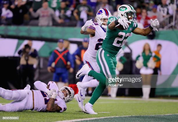 Running back Matt Forte of the New York Jets avoids a tackle strong safety Micah Hyde of the Buffalo Bills to score a touchdown during the fourth...