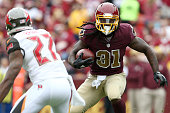 Running back Matt Jones of the Washington Redskins carries the ball while cornerback Johnthan Banks of the Tampa Bay Buccaneers defends in the second...