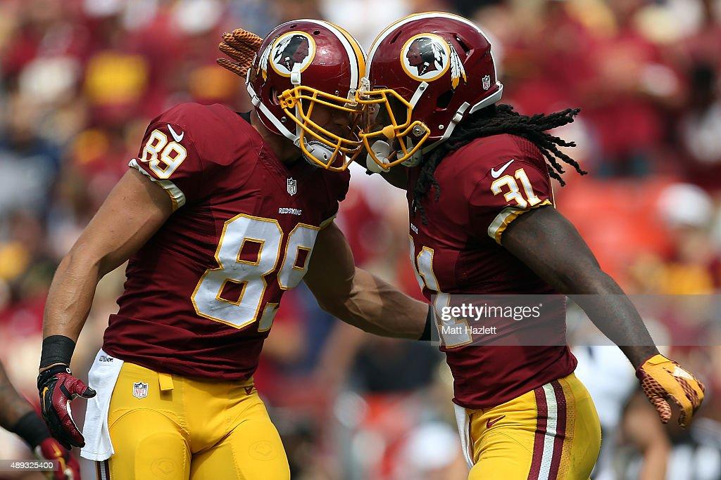 Running back Matt Jones of the Washington Redskins celebrates with tight end Derek Carrier of the Washington Redskins after a first quarter touchdown...