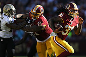 Running back Matt Jones of the Washington Redskins rushes for a second quarter touchdown against the New Orleans Saints at FedExField on November 15...