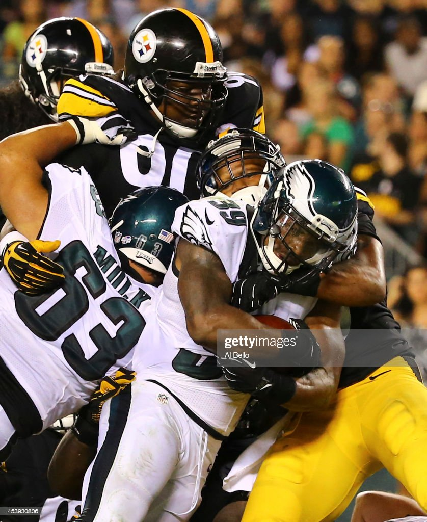Running back Matthew Tucker of the Philadelphia Eagles scores a touchdown against the Pittsburgh Steelers on August 21 2014 at Lincoln Financial...