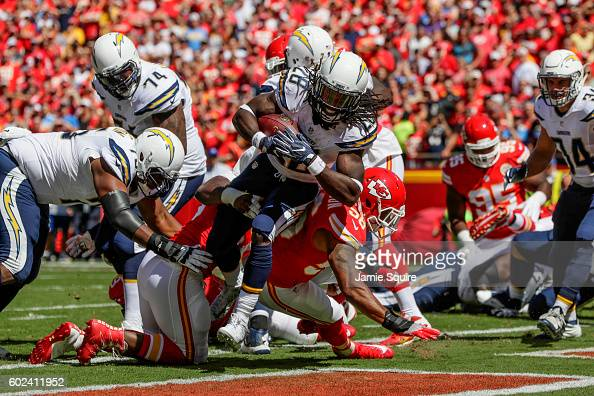 Running back Melvin Gordon of the San Diego Charger fights through tackle of inside linebacker Derrick Johnson of the Kansas City Chiefs to score the...