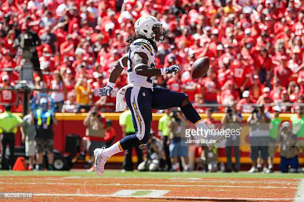 Running back Melvin Gordon of the San Diego Chargers high steps through the end zone after spinning to break a tackle for his second touchdown of the...