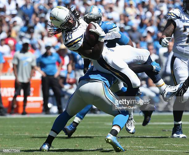 Running back Melvin Gordon of the San Diego Chargers is tacked by the Detroit Lions defense at Qualcomm Stadium on September 13 2015 in San Diego...