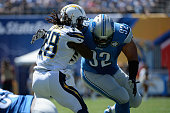 Running back Melvin Gordon of the San Diego Chargers is tackled by defensive tackle Haloti Ngata of the Detroit Lions at Qualcomm Stadium on...