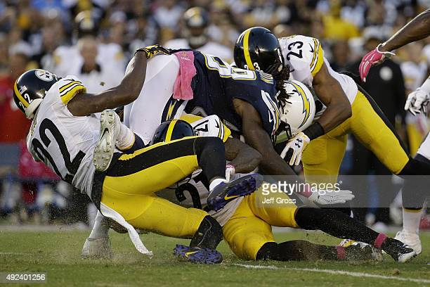 Running back Melvin Gordon of the San Diego Chargers is tackled by cornerback William Gay and the Pittsburgh Steeler defense at Qualcomm Stadium on...