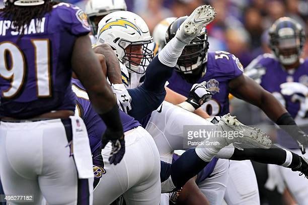 Running back Melvin Gordon of the San Diego Chargers is tackled by Baltimore Ravens defenders during the second half at MT Bank Stadium on November 1...