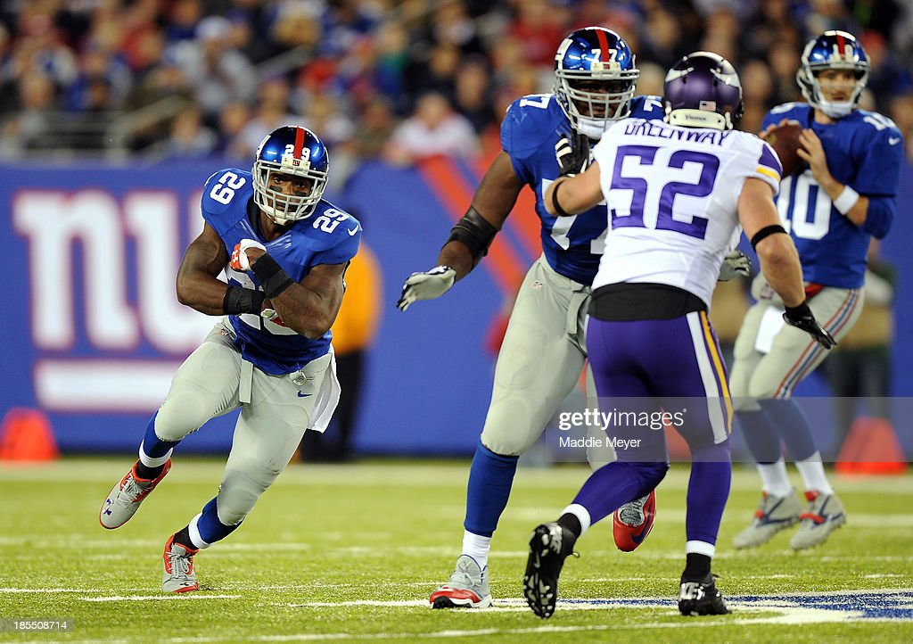 Running back Michael Cox #29 of the New York Giants runs with the ball against the Minnesota Vikings during a game at MetLife Stadium on October 21, 2013 in East Rutherford, New Jersey.