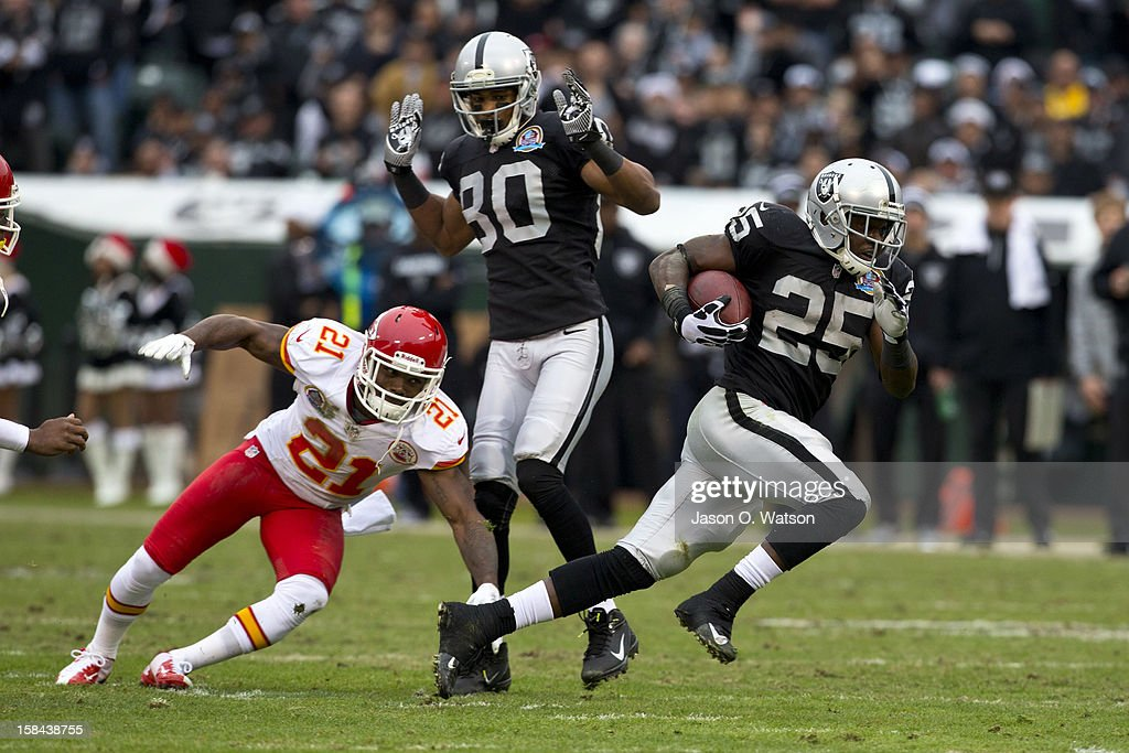 Running back Mike Goodson #25 of the Oakland Raiders rushes past cornerback Javier Arenas #21 of the Kansas City Chiefs during the first quarter at O.co Coliseum on December 16, 2012 in Oakland, California.