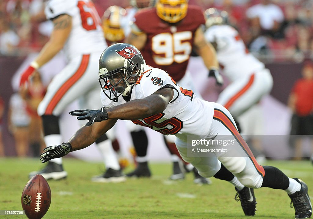 Running back <a gi-track='captionPersonalityLinkClicked' href=/galleries/search?phrase=Mike+James+-+American+Football+Player&family=editorial&specificpeople=13541394 ng-click='$event.stopPropagation()'>Mike James</a> #25 of the Tampa Bay Buccaneers dives for a pass in the first quarter against the Washington Redskins August 29, 2013 at Raymond James Stadium in Tampa, Florida.